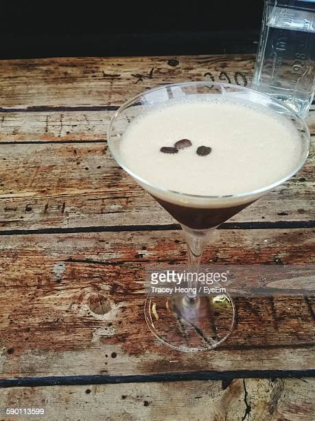 high angle view of espresso martini on table - espresso stock photos and pictures