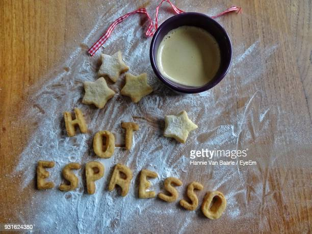 High Angle View Of Espresso With Text On Table