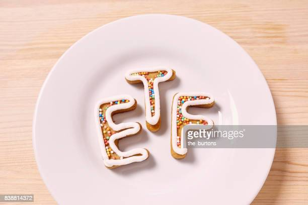 High angle view of ETF letters on plate, symbol of investment in stocks