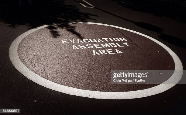 high angle view of evacuation sign on street - evacuation stock pictures, royalty-free photos & images