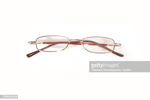 high angle view of eyeglasses against white background - reading glasses stock pictures, royalty-free photos & images