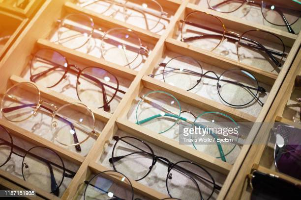 high angle view of eyeglasses for sale in store - eyeem collection stock pictures, royalty-free photos & images