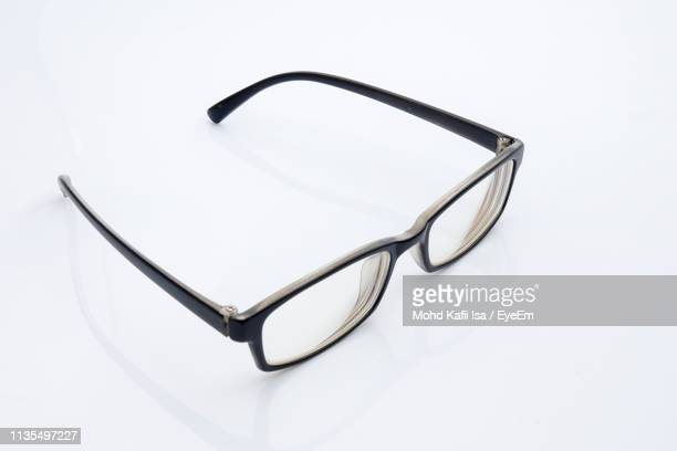 high angle view of eyeglasses on gray background - reading glasses stock pictures, royalty-free photos & images