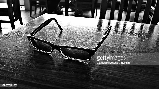 high angle view of eyeglasses on table - campbell downie stock pictures, royalty-free photos & images