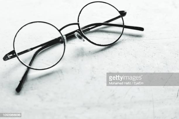 high angle view of eyeglasses on white background - reading glasses stock pictures, royalty-free photos & images