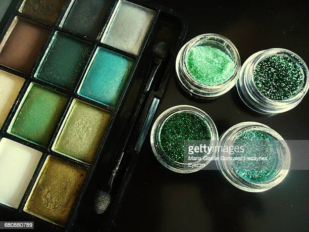 High Angle View Of Eyeshadow Next To Glitters
