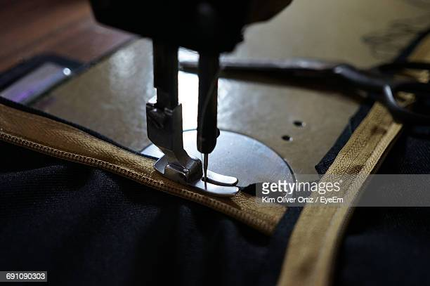 High Angle View Of Fabric On Sewing Machine
