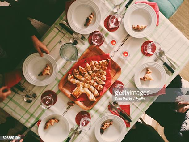 High Angle View Of Family Having Lunch During Christmas
