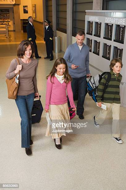 High angle view of family walking in airport