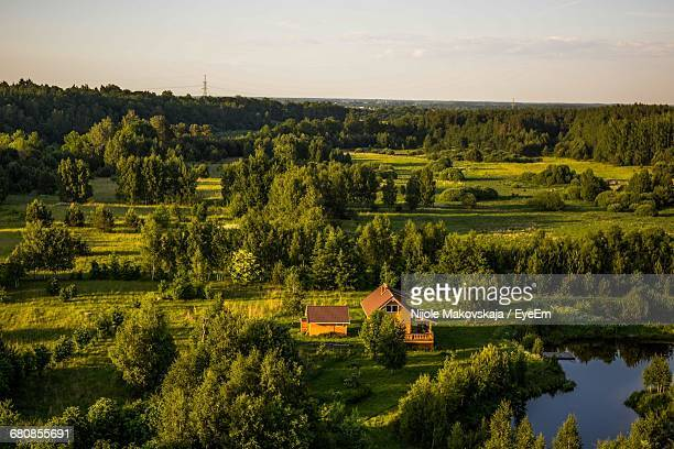 High Angle View Of Farmhouse With Trees And Grass