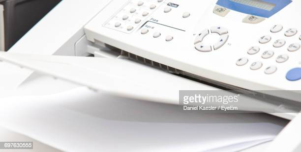 High Angle View Of Fax Machine In Office