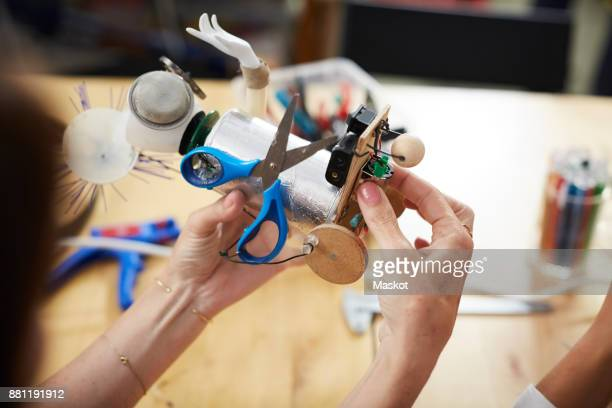 high angle view of female engineers making robot model at workshop - inventor stock pictures, royalty-free photos & images