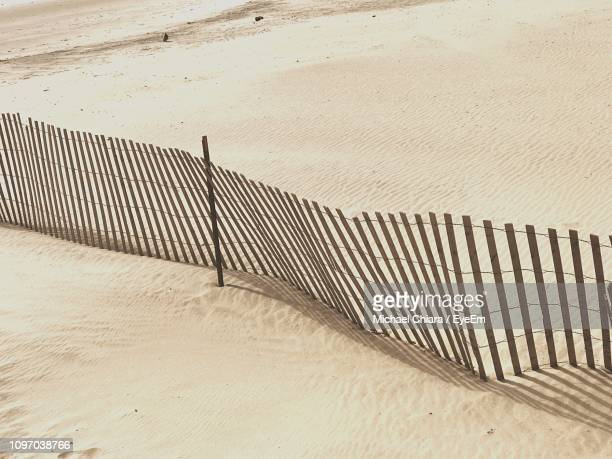 high angle view of fence at beach - coney island stock pictures, royalty-free photos & images
