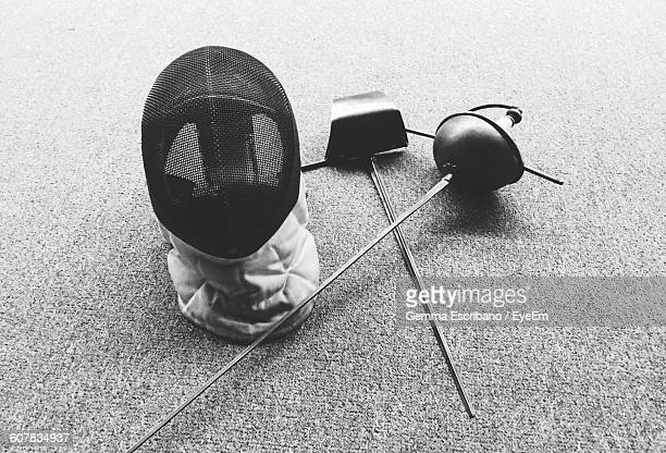 high angle view of fencing foils and mask on floor - face guard sport stock pictures, royalty-free photos & images