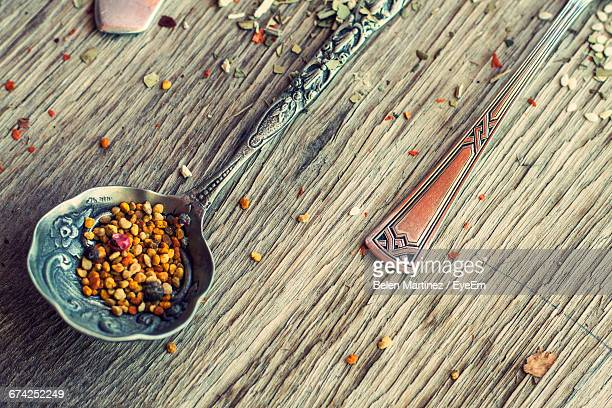 High Angle View Of Fenugreek Seeds On Vintage Spoon At Table