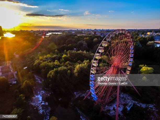 high angle view of ferris wheel at spreepark during sunset - 観覧車 ストックフォトと画像