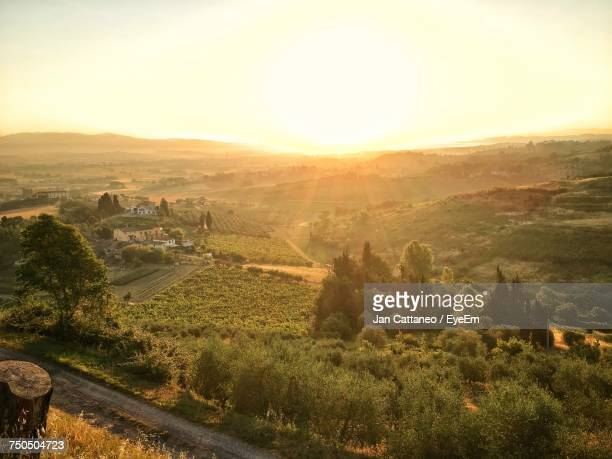 high angle view of field against sky during sunset - san miniato stock pictures, royalty-free photos & images