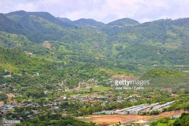 high angle view of field and mountains against sky - managua stock pictures, royalty-free photos & images