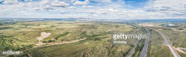 High Angle View Of Field And Mountains Against Sky
