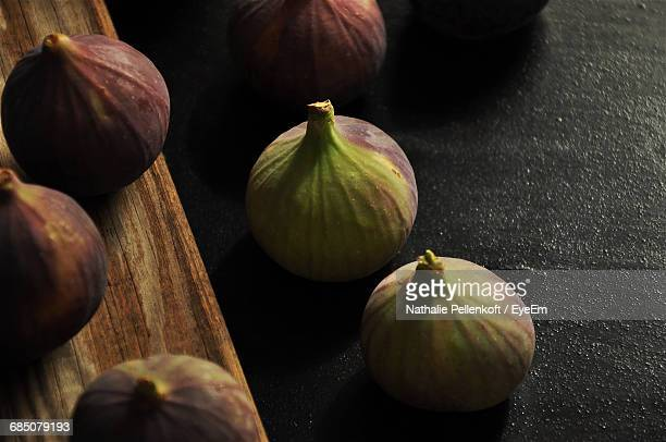 high angle view of figs on table - nathalie pellenkoft stock pictures, royalty-free photos & images