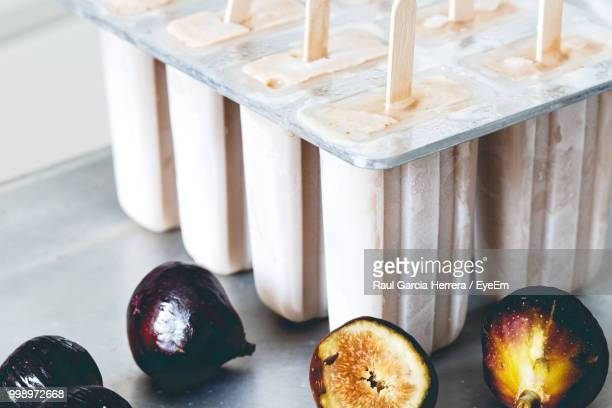 High Angle View Of Figs With Popsicle On Table