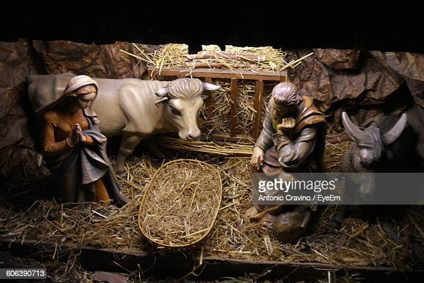 high angle view of figurines in church during christmas - nativity stock photos and pictures