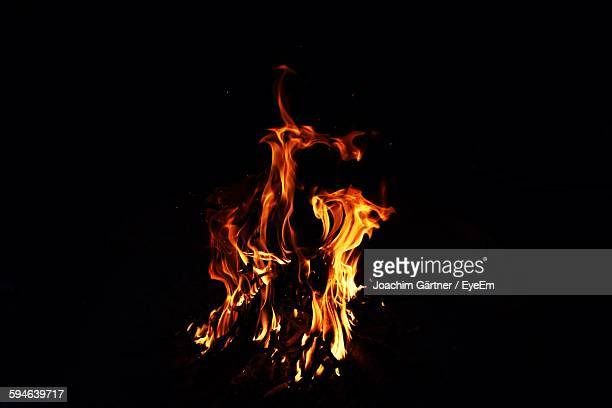 High Angle View Of Fire Against Black Background