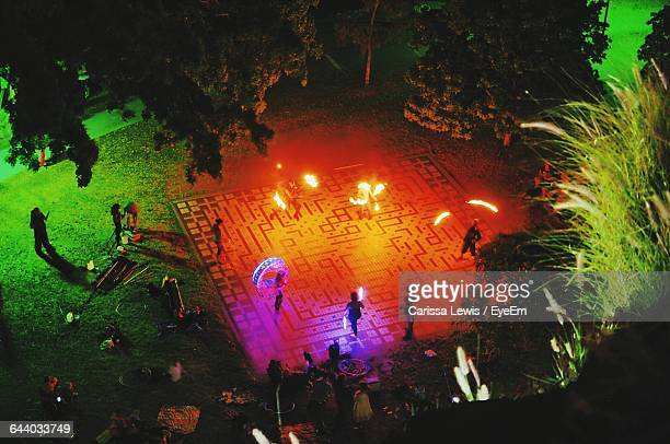 High Angle View Of Fire Dancers In Park At Night