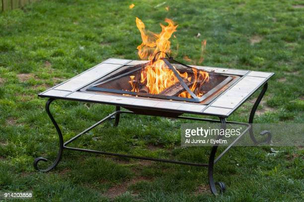 high angle view of fire pit at yard - fire pit stock pictures, royalty-free photos & images