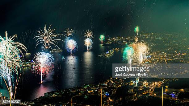 High Angle View Of Firework Display At Madeira Island During New Year Eve
