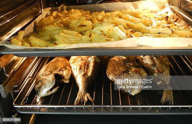 High Angle View Of Fish And Chips In Microwave Oven At Home