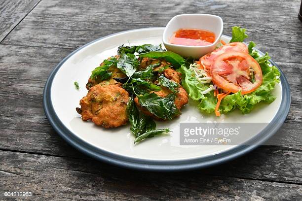 High Angle View Of Fish Cutlets Served In Plate On Table