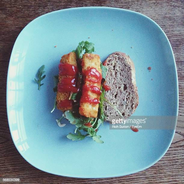 High Angle View Of Fish Finger Sandwich In Plate On Table