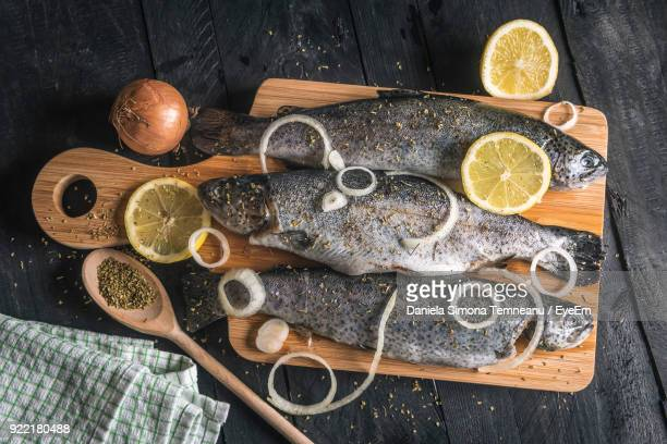 high angle view of fish on cutting board - trout stock pictures, royalty-free photos & images