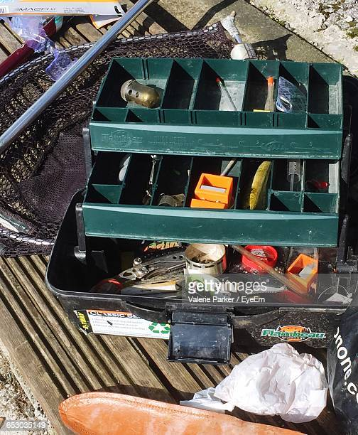 high angle view of fishing box on bench - fishing tackle stock pictures, royalty-free photos & images