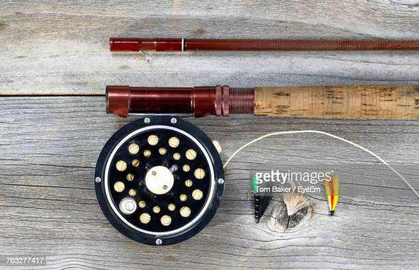 High Angle View Of Fishing Equipment On Wooden Table