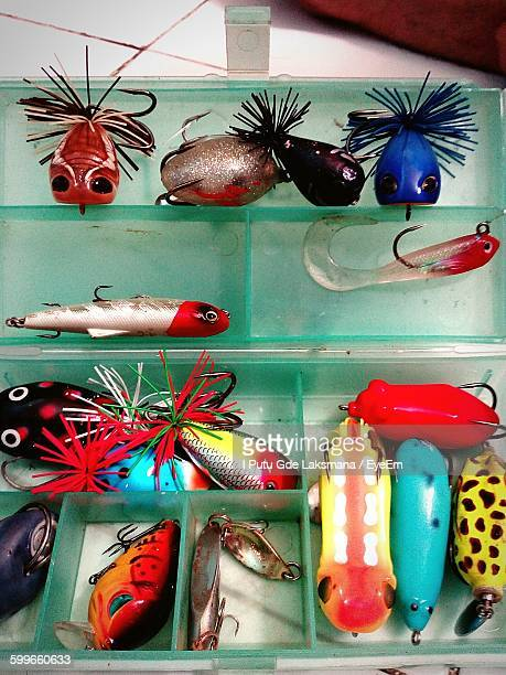 high angle view of fishing lures in box - fishing tackle stock pictures, royalty-free photos & images