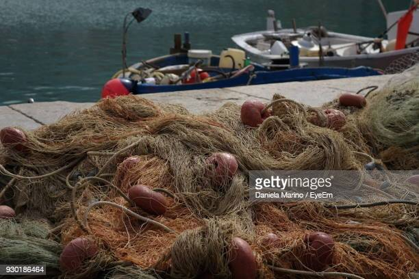 High Angle View Of Fishing Nets On Pier At Harbor
