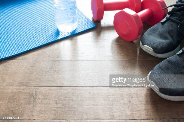 High Angle View Of Fitness Equipment On Hardwood Floor