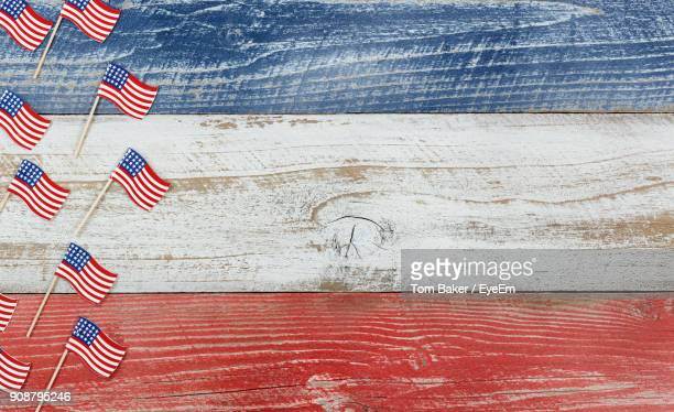 High Angle View Of Flags On Wooden Table