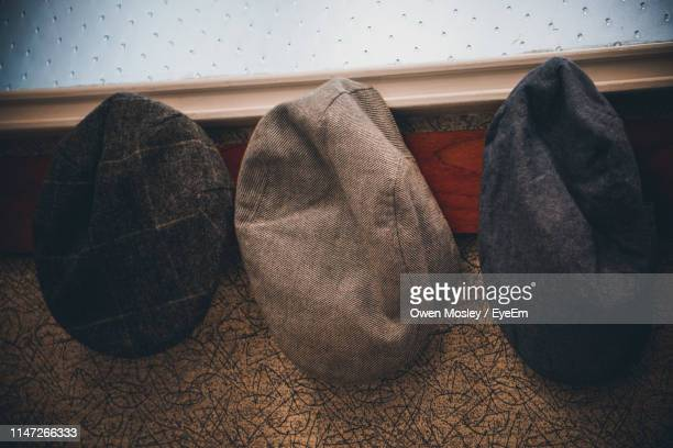 high angle view of flat caps - flat cap stock photos and pictures