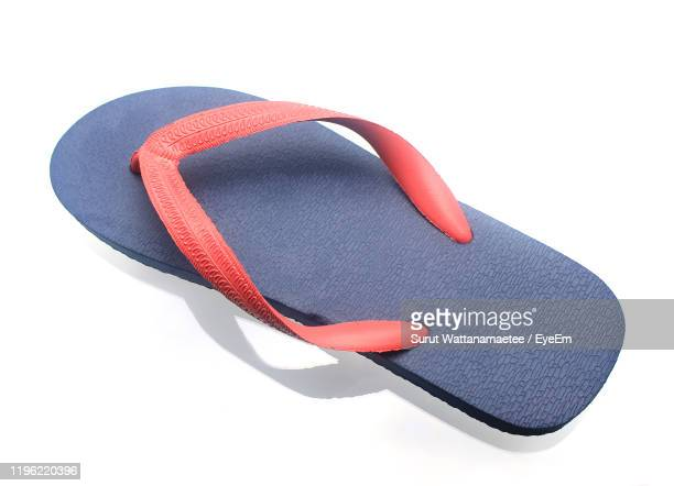 high angle view of flip-flop against white background - flip flop stock pictures, royalty-free photos & images