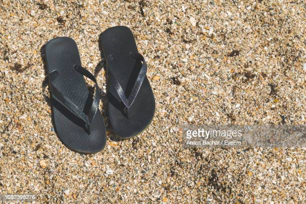 High Angle View Of Flip-Flop On Sand