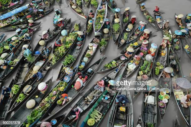 high angle view of floating market - floating market stock photos and pictures