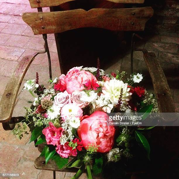 High Angle View Of Flower Bouquet In Wooden Chair