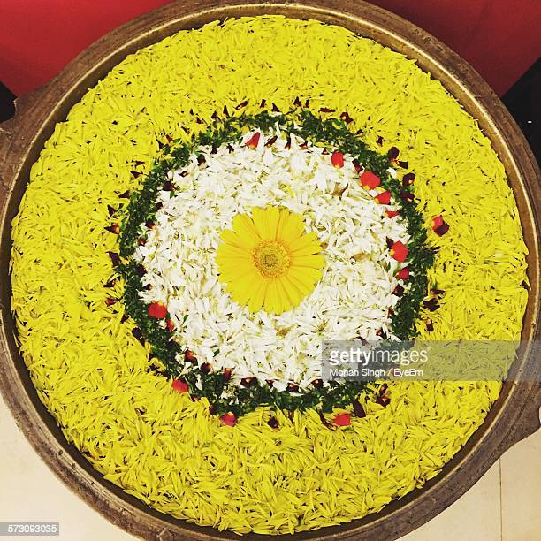 high angle view of flower decoration in plate - rangoli stock pictures, royalty-free photos & images