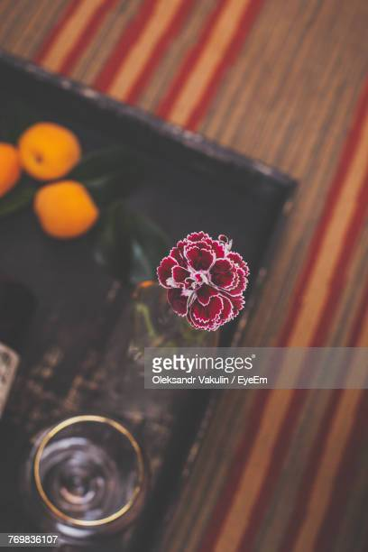 High Angle View Of Flower In Vase On Tray Over Table