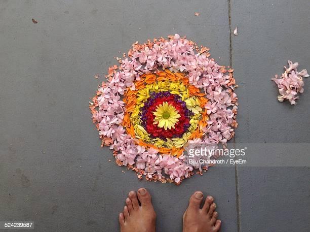 high angle view of flower rangoli and feet - rangoli stock pictures, royalty-free photos & images
