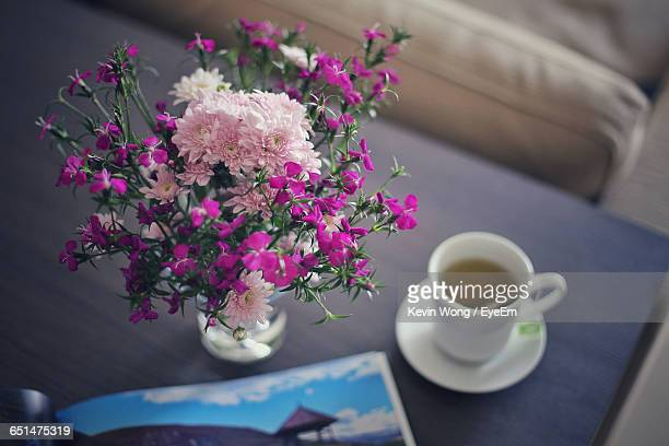 High Angle View Of Flower Vase And Tea Cup On Table At Home