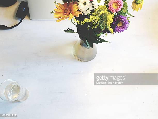 high angle view of flower vase on table - danielle reid stock pictures, royalty-free photos & images